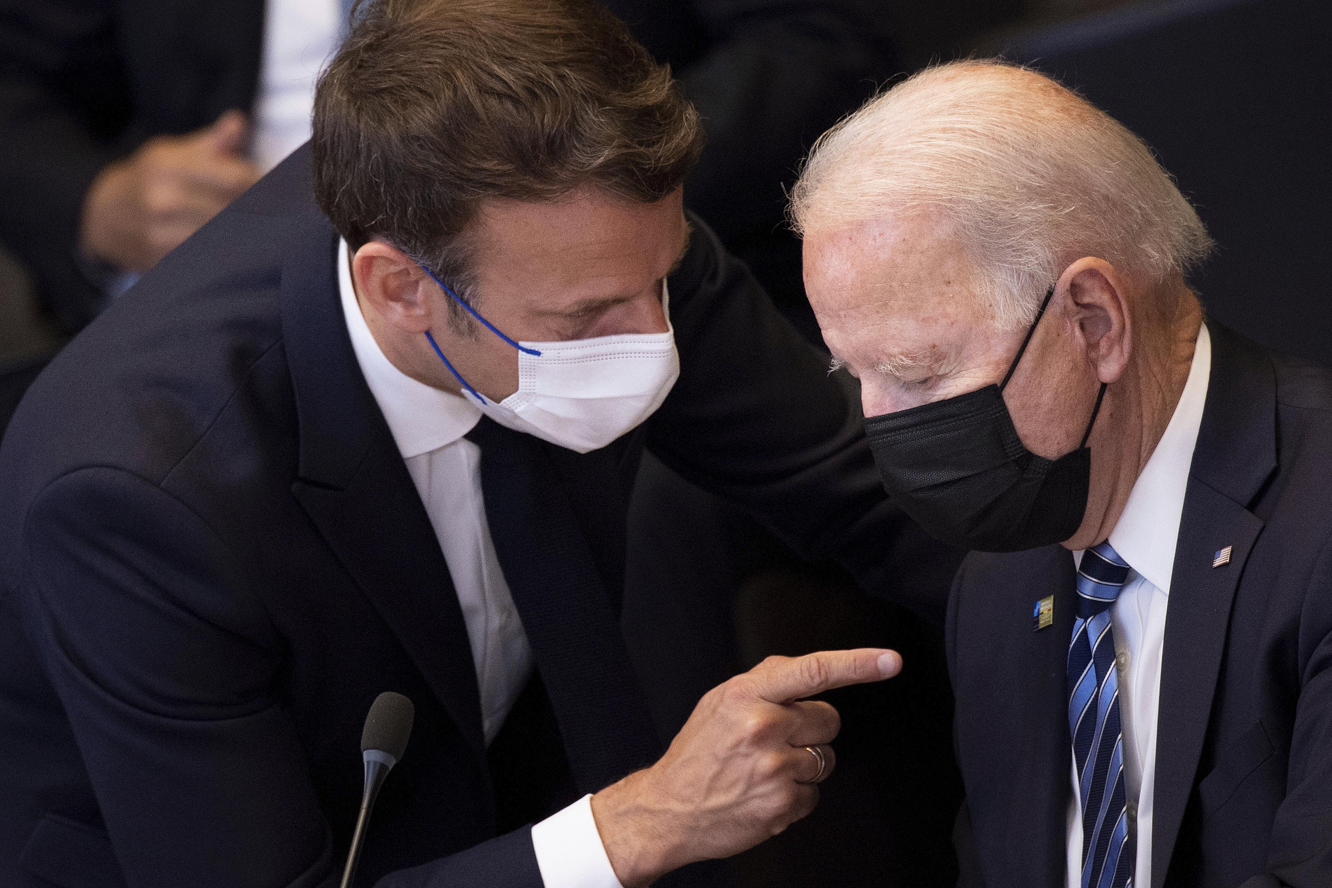 US President Joe Biden, right, speaks with French President Emmanuel Macron during a NATO summit back in June 2021.