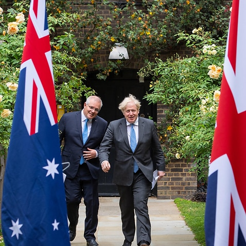 PABEST Prime Minister Boris Johnson with Australian Prime Minister Scott Morrison in the garden of 10 Downing Street, London, after agreeing the broad terms of a free trade deal between the UK and Australia, the UK's first trade deal negotiated fully sinc