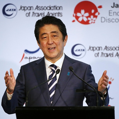 Japanese Prime Minister Shinzo Abe delivers the keynote speech