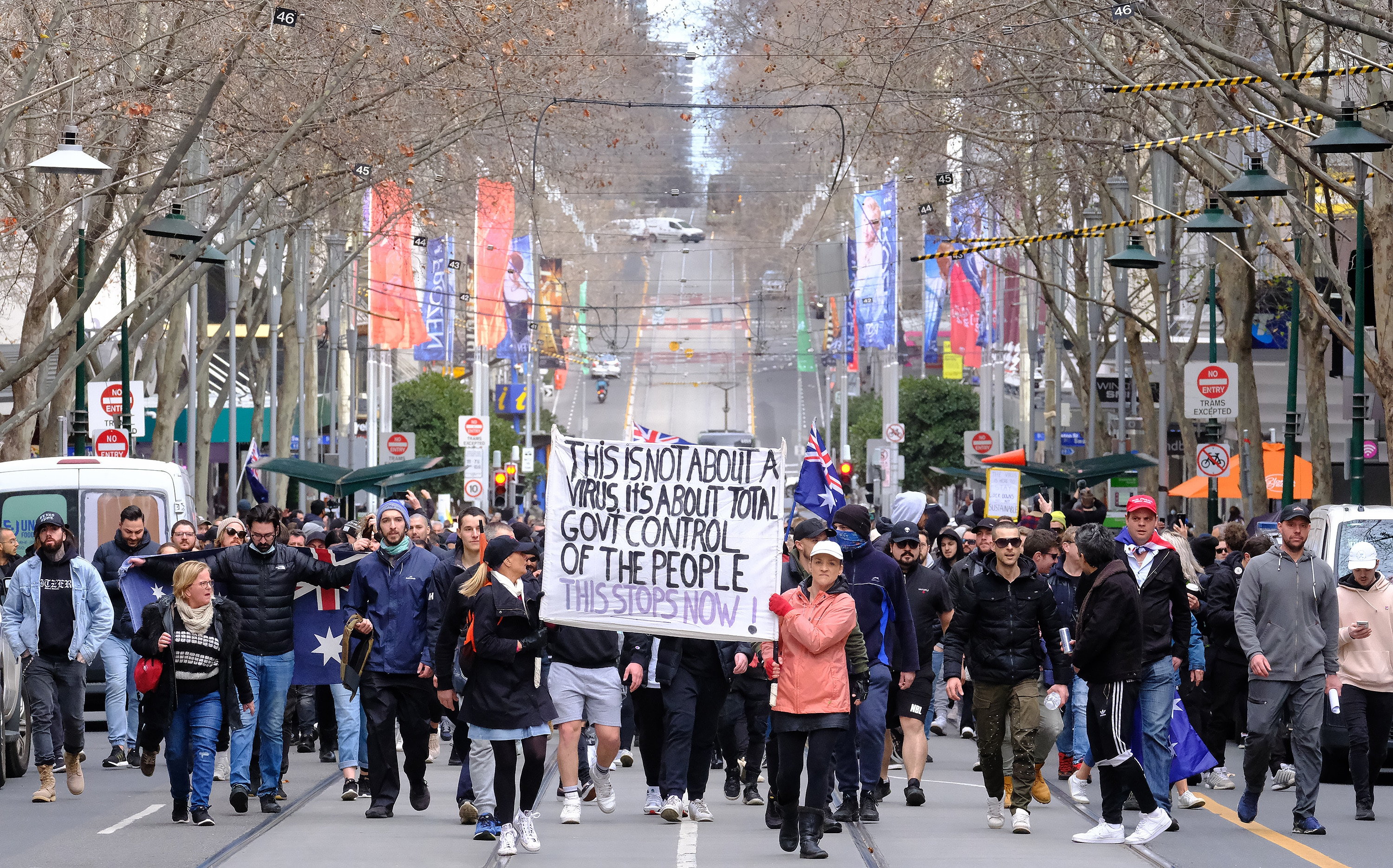 Protesters are seen during the 'World Wide Rally For Freedom' anti-lockdown rally in Melbourne, Saturday, July 24, 2021. (AAP Image/Luis Ascui) NO ARCHIVING