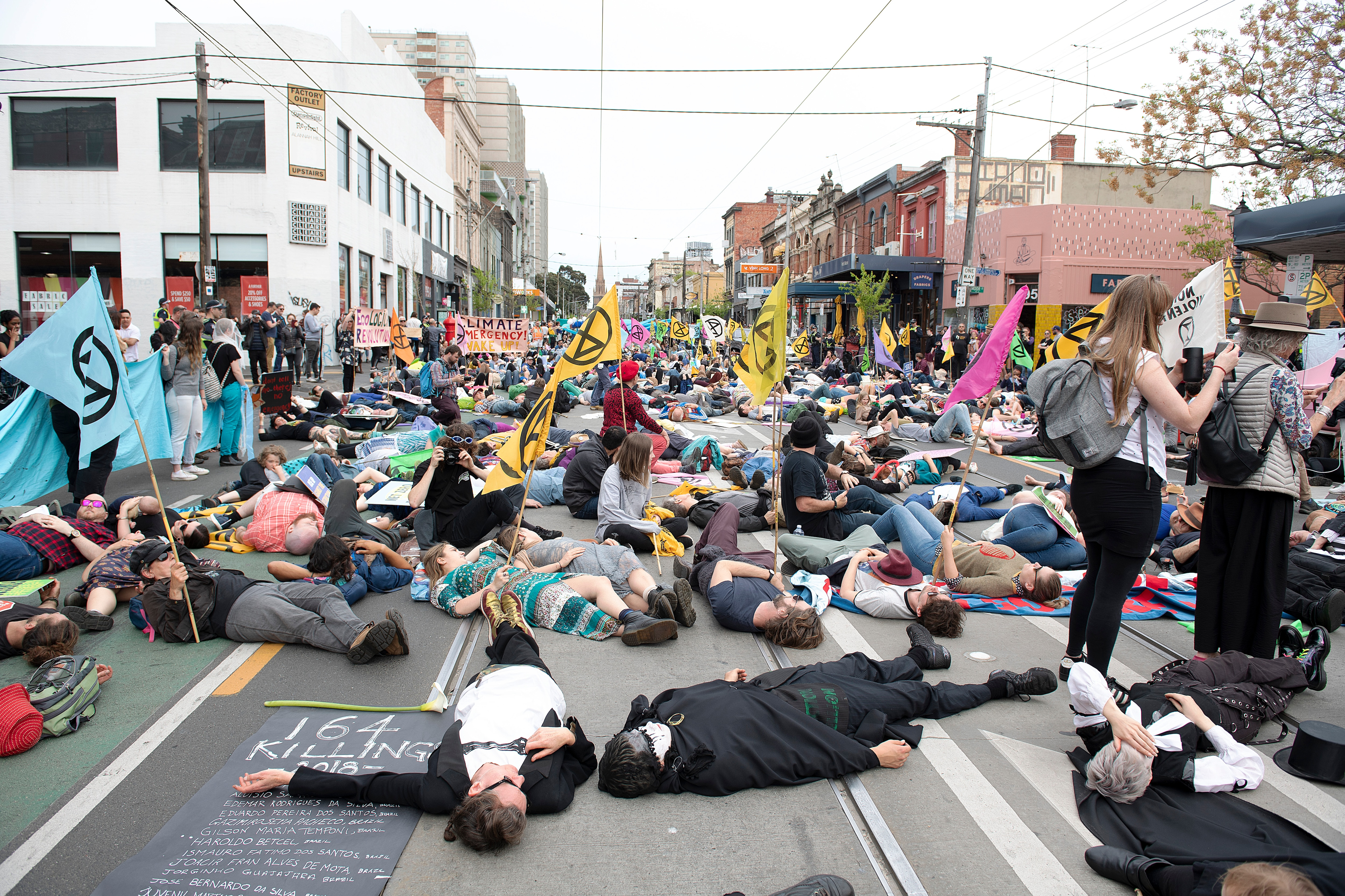 Extinction Rebellion activists lie down on the road.