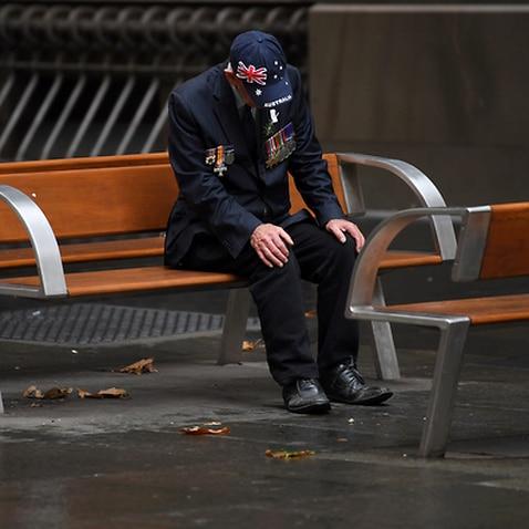 An elderly man sits after attending an Anzac Day Dawn Service in Sydney