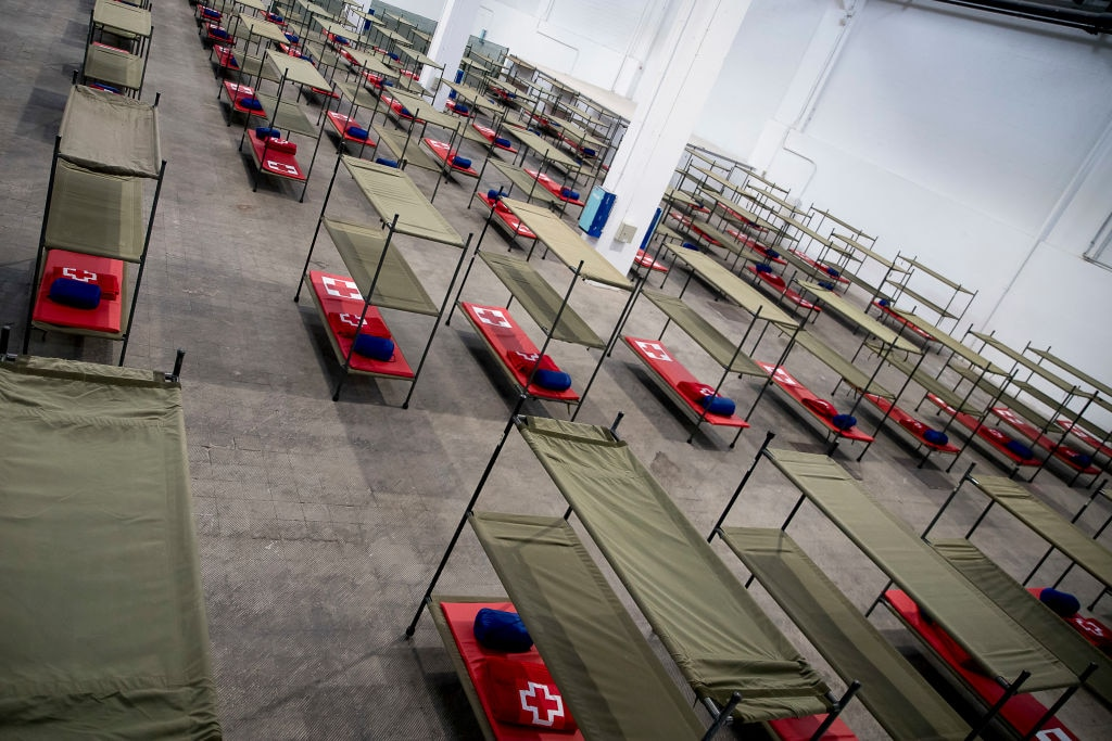General view of beds set up at a temporary hospital for vulnerable people at the Fira Barcelona Montjuic centre in Barcelona
