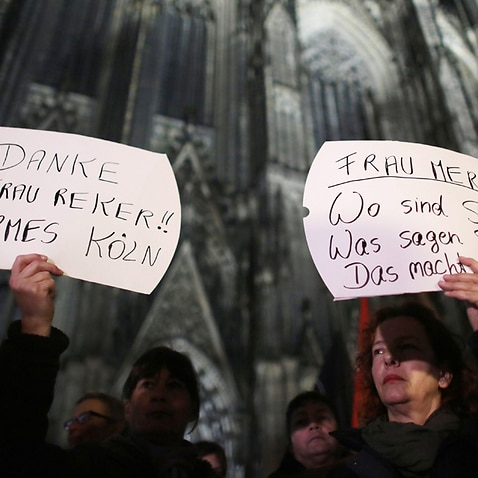 Women protest against sexism outside the Cologne cathedral