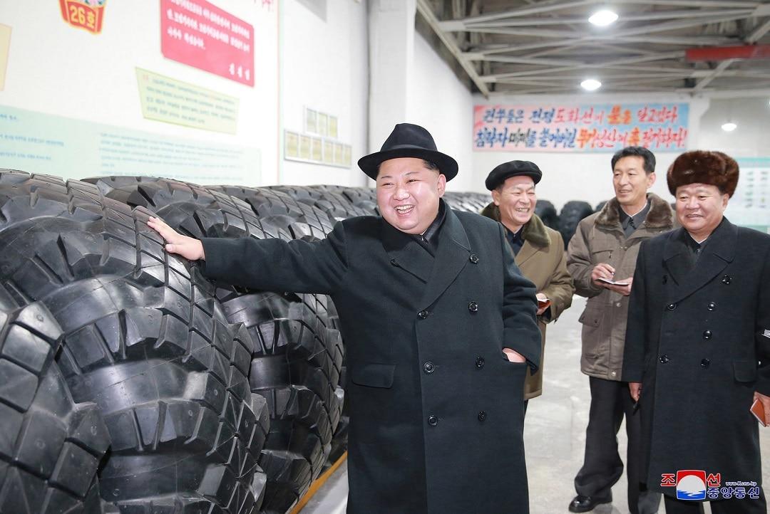 North Korean leader Kim Jong Un inspects a local tire factory.