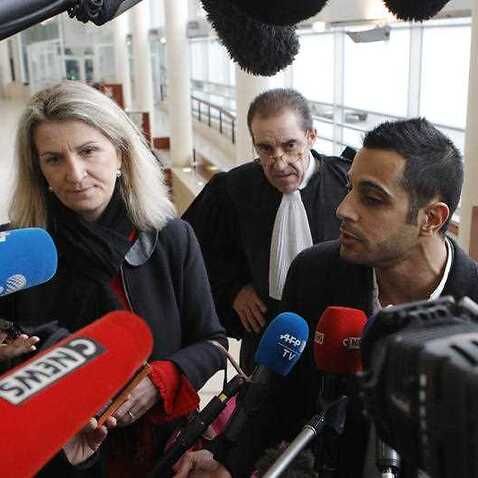 Lawyers for the suspect Marc Goudarzian and Sandrine Parise-Heideiger, left, answer reporters at the hall of justice Tuesday, February 13, 2018 in Pontoise, outside Paris.