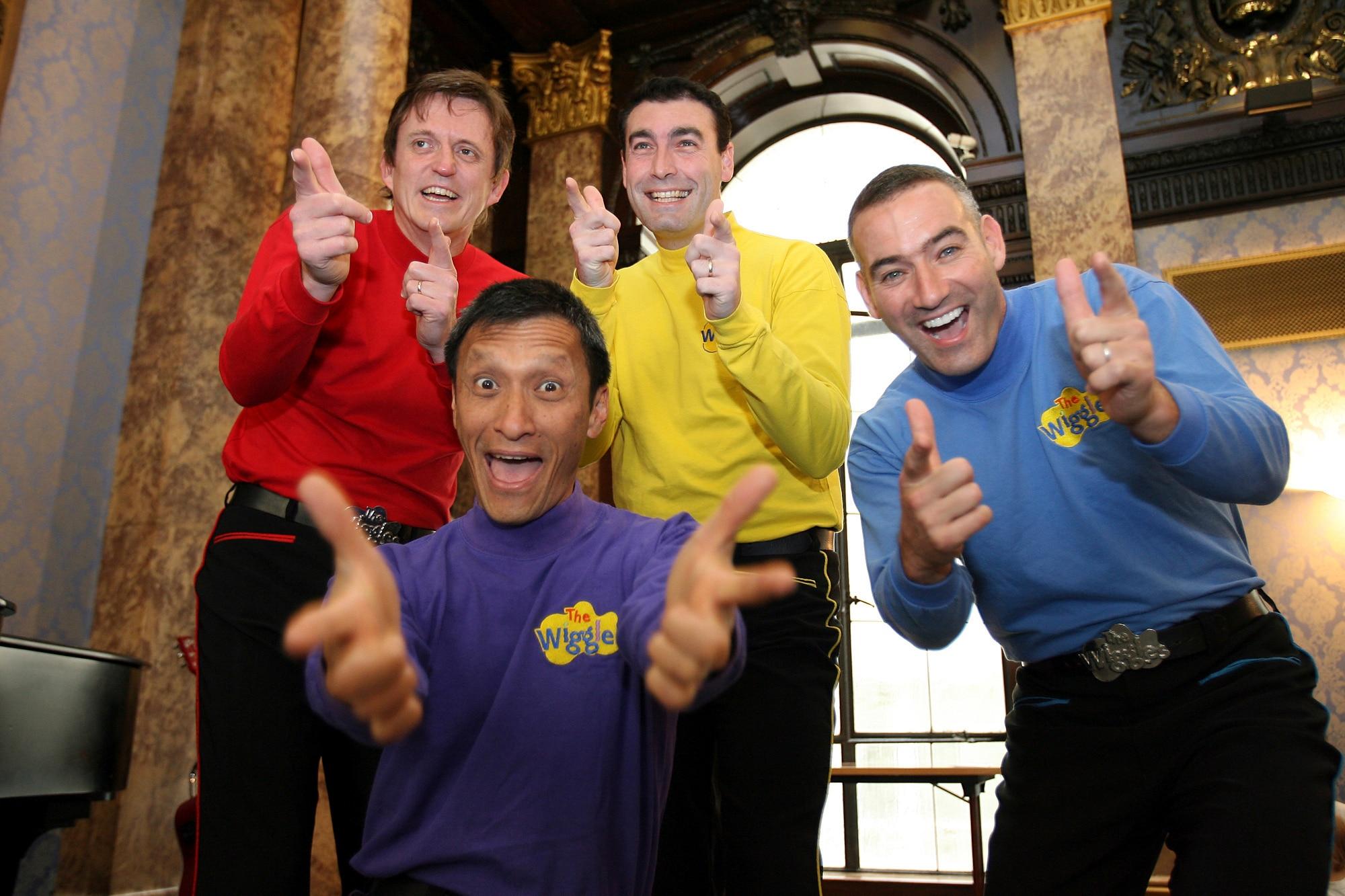Australian children's entertainers The Wiggles, Murray Cook (Red Wiggle), Greg Page (Yellow Wiggle), Jeff Fatt (Purple Wiggle),