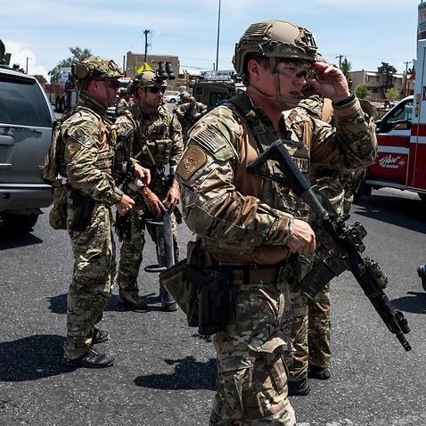 Police swarm the area around the Walmart near Cielo Vista Mall in El Paso, Texas, where the shooting occurred.