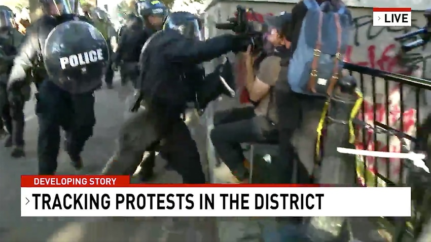 Network Seven cameraman Tim Myers assaulted by police officers while covering protests outside the White House in Washington.