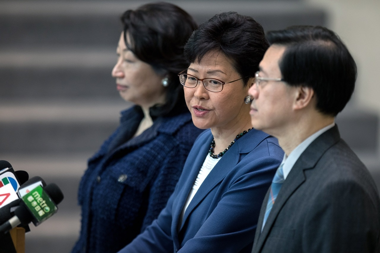 Hong Kong Chief Executive Carrie Lam (C) says she will not withdraw the controversial extradition bill or resign as chief executive, despite mass protests.