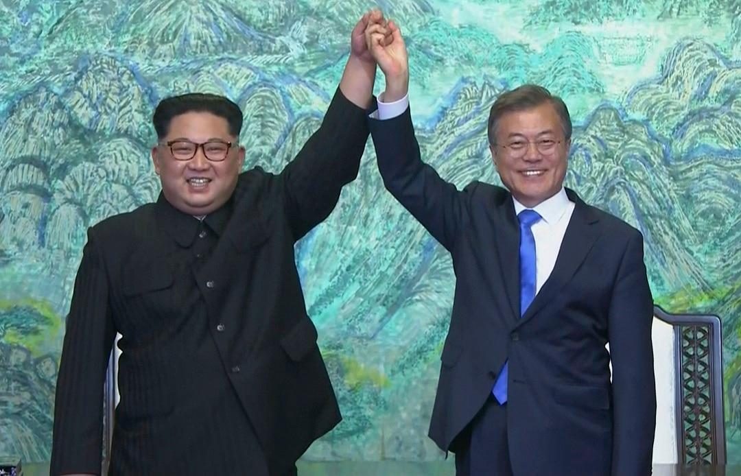 North Korean leader Kim Jong-un, left, and South Korean President Moon Jae-in on Friday.